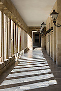 Light and shade and lanterns in corridor of Palace of St Michael and St George, Museum of Asian Art in Kerkyra, Corfu Town, Greece