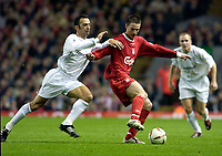 Photo. Jed Wee.<br /> Liverpool v Bolton Wanderers, Carling Cup, Anfield, Liverpool. 03/12/03.<br /> Liverpool's Anthony Le Tallec (R) holds off Bolton's Youri Djorkaeff.