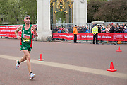 Portuguese para-athlete Manuel Mendes running at The Mall during the Virgin London Marathon on 28th April 2019 in London in the United Kingdom. Now in it's 39th year, the London Marathon is a large sporting event with over 40,000 runners expected to take part.
