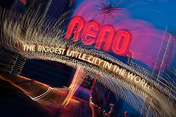 """""""Downtown Reno 1""""  This Reno The Biggest Little City in the World sign, also know at the Reno Arch,  was photographed in Reno, Nevada. The effect was obtained in camera by long exposure mixed with intentional camera movement."""