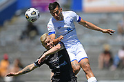 Hamilton Wanderers Jordan Lamb goes high over Hawkes Bay United's Kailan Gould in the Handa Premiership football match, Hawke's Bay United v Hamilton Wanderers, Bluewater Stadium, Napier, Sunday, November 15, 2020. Copyright photo: Kerry Marshall / www.photosport.nz