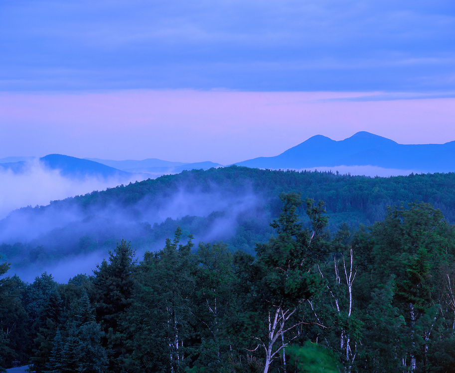 Forested hills & blue ridgelines, Percy Peaks & rising fog at dawn, summer, Milan Hills State Park, Milan, NH