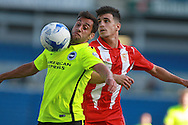 Sam Baldock competes for a high ball withJose Matos during the Pre-Season Friendly match between Brighton and Hove Albion and Sevilla at the American Express Community Stadium, Brighton and Hove, England on 2 August 2015. Photo by Bennett Dean.