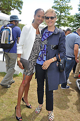 Left to right, MICHELLE MOSES and CARLA BAMBERGER at a luncheon hosted by Cartier for their sponsorship of the Style et Luxe part of the Goodwood Festival of Speed at Goodwood House, West Sussex on 1st July 2012.