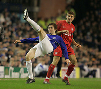 Photo: Dave Howarth.<br /> Everton v Liverpool. The Barclays Premiership. 28/12/2005.  Everton's Kevin Kilbane tries an overhead kick against Liverpool's Steven Gerrard