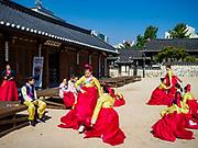 "SEOUL, SOUTH KOREA: South Korean girls, wearing traditional ""Hanbok"" clothing, dance in Namsan Park in central Seoul.      PHOTO BY JACK KURTZ"