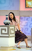 """Participant, Tang Min, 28 on the set of 'Collectors World"""" to determine if her  family heirloom  is real or fake. Tamg said the vase belonged to her grandfather but experts deemed the vase to be fake and it was smashed with a golden hammer."""