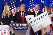 Billionaire and GOP presidential candidate Donald Trump addresses supporters alongside wife Melania, daughter Ivanka and Lt. Gov. Henry McMasters as they celebrate victory in the South Carolina Republican primary February 20, 2016 in Spartanburg, South Carolina, USA .