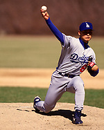 CHICAGO - CIRCA 1995:  Chan Ho Park of the Los Angeles Dodgers pitches during an MLB game versus the Chicago Cubs at Wrigley Field in Chicago, Illinois during the 1995 season. (Photo by Ron Vesely) Subject:   Chan Ho Park