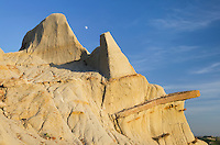 Moon over badlands sandstone formations Theodore Rossevelt National Park, North Dakota