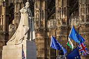 As Prime Minister Theresa May tours European capitals hoping to persuade foreign leaders to accept a new Brexit deal (following her cancellation of a Parliamentary vote), pro-EU Remainers protest beneath the statue of King George V beneath Westminster Abbey and opposite the Houses of Parliament, on 11th December 2018, in London, England.