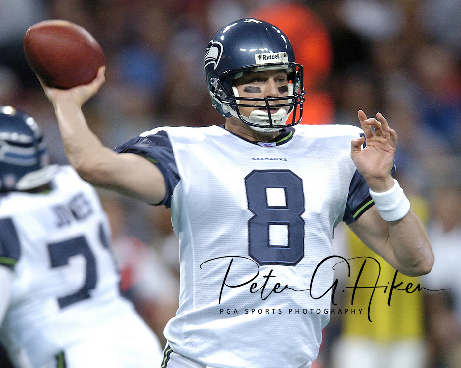 Seattle quarterback Matt Hasselbeck gets ready to throw the ball down field in the first quarter against the St. Louis Rams in St. Louis, Missouri, November 14, 2004.