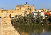 River Rio Guadalquivir and historic Mezquita cathedral buildings, Great Mosque, Cordoba, Spain