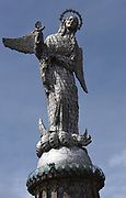 Detail of the huge aluminium covered statue of the Virgin of Quito. The statue is sited on the top of the hill above Quito called El Panecillo. It was built in 1975 and is based on the on the Virgin of Legarda or Apocalyptic, an 18th century work by Bernardo de Legarda. El Panecillo, Quito, Ecuador.