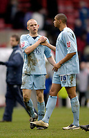 Photo: Jed Wee.<br />Nottingham Forest v Chesterfield. Coca Cola League 1.<br />31/12/2005.<br />Chesterfield's Derek Niven (L) and Caleb Folan celebrate their gritty draw.