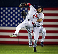 Oakland, CA -- Red Sox players Johnny Damon and Damian Jackson collide in centerfield with Jackson making the catch to end the 7th inning during the ALDS Game 5 as the Oakland Athletics host the Boston Red Sox on Monday, October 6, 2003. -- Photo by Jack Gruber, USA TODAY