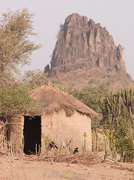 Rhumsiki rock, in the north of Cameroon. This pillar is the funnel of an extinct volcano, where the set rock is extremely hard. The softer rock  mountainside around has long since eroded away.