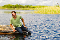 handsome rugged man outdoors by the water in Florida