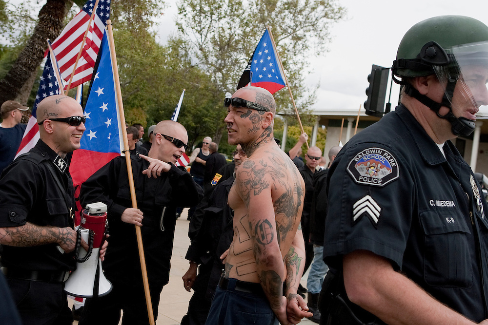 Members of the National Socialist Movement, a Neo Nazi group, rallies in Claremont, California against illegal immigration. Please contact Todd Bigelow directly with your licensing requests.