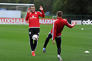 Gareth Bale of Wales puts his hands up as he trains with Aaron Ramsey (r)   during the Wales football team training in Hensol, Vale of Glamorgan in South Wales on Tuesday 6th October 2015.the team are preparing for their next Euro 2016 qualifying match this weekend.<br /> pic by  Andrew Orchard, Andrew Orchard sports photography.
