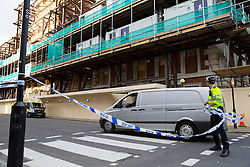 © licensed to London News Pictures. London, UK 14/04/2014. A private ambulance arrives at the scene in London's Grosvenor Square where part of a building collapsed and killed a man on Monday afternoon of April 14, 2014. Photo credit: Tolga Akmen/LNP