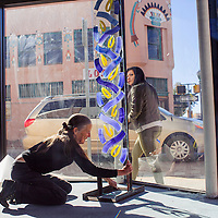 110614       Cable Hoover<br /> <br /> Be Sargent places one her sculptures in the display window of Art123 Gallery in downtown Gallup Thursday.