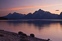 Sunset over the Teton Range and Jackson Lake.  Grand Teton National Park.  Wyoming, USA.
