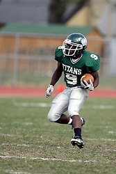 10 November 2007: Marcus Dunlop in the open field.  This game between the Wheaton College Thunder and the Illinois Wesleyan University Titans was for a share of the CCIW Championship and was played at Wilder Field on the campus of Illinois Wesleyan University in Bloomington Illinois.
