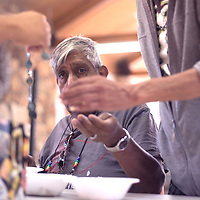 Jerry Archuleta helps separate beads before a jewelry workshop hosted by Marco Arviso September 27 at the Northwest New Mexico Pride gathering in the Kiwanis campground Vanderwagon.