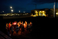 Activists gather during a vigil outside the U.S. Border Patrol station in Clint, Texas, July 27, 2019. The Border Patrol station has received criticism for previous reports of inadequate and poor conditions for migrants being held at the facility.