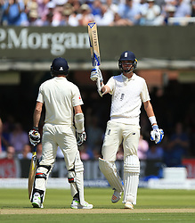 England's Stuart Broad raises his bat after reaching a half century during day two of the First Investec Test match at Lord's, London. PRESS ASSOCIATION Photo. Picture date: Friday July 7, 2017. See PA story CRICKET England. Photo credit should read: Nigel French/PA Wire. RESTRICTIONS: Editorial use only. No commercial use without prior written consent of the ECB. Still image use only. No moving images to emulate broadcast. No removing or obscuring of sponsor logos.