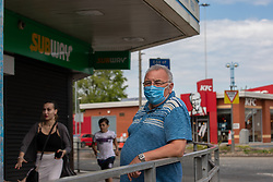 © Licensed to London News Pictures .  07/05/2020 . Salford, UK. A man wearing a facemask outside a branch of Subway sandwiches , on Hankinson Way in Salford . Photo credit : Joel Goodman/LNP