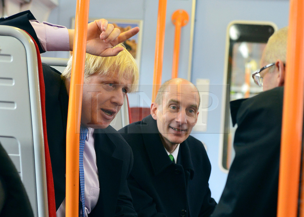© Licensed to London News Pictures. 14/05/2013. London, UK (Left to right). Boris Johnson, Lord Adonis, Chairman of the Crossrail 2 Task Force for London First, David Higgins, Network Rail Chief Executive talk on a train back to Waterloo Station in Central London. The Mayor of London, Boris Johnson, leads a short walkabout around Wimbledon High Street to meet local people as he helps launch a public consultation on proposed routes for Crossrail 2. Today 14th May 2013. Photo credit : Stephen Simpson/LNP