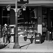 A Caballero leaning against an old pay phone box, taking a quick siesta. <br /> San Antonio, TX