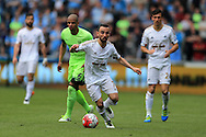 Leon Britton of Swansea city breaks away from Fernando of Manchester city.Barclays Premier league match, Swansea city v Manchester city at the Liberty Stadium in Swansea, South Wales on Sunday 15th May 2016.<br /> pic by Andrew Orchard, Andrew Orchard sports photography.