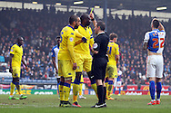 Giuseppe Bellusci of Leeds United receives a yellow card from referee Keith Stroud. Skybet football league Championship match, Blackburn Rovers v Leeds United at Ewood Park in Blackburn, Lancs on Saturday 12th March 2016.<br /> pic by Chris Stading, Andrew Orchard sports photography.