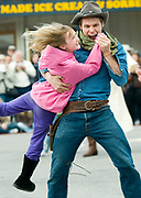 PRICE CHAMBERS / NEWS&GUIDE<br /> Brock Harris scoops up audience member Kay Tollison for a dance at the Jackson Hole Shootout on Saturday. The Jackson tradition continues all summer, Monday through Saturday at 6 p.m.