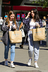 © Licensed to London News Pictures. 15/06/2020. London, UK. Shoppers with shopping bags leave Primark in Wood Green, north London as non-essential stores reopen after three months of COVID-19 lockdown. Photo credit: Dinendra Haria/LNP