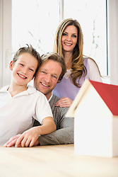 Family with architectural model at table