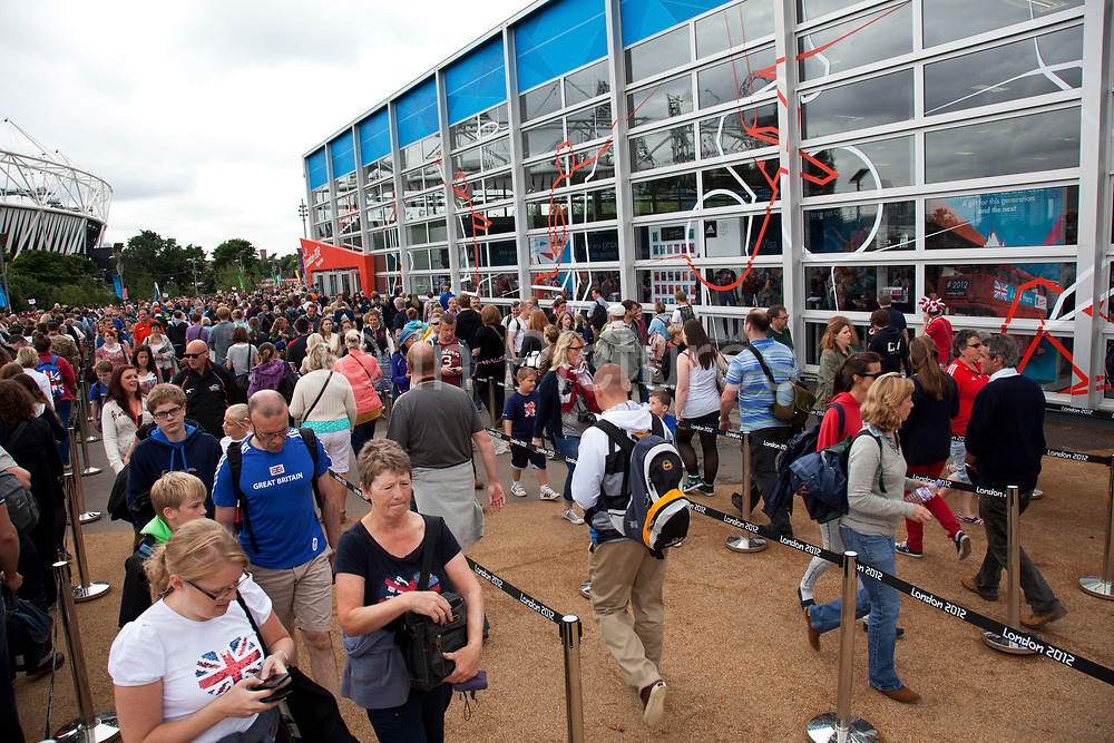 London 2012 Olympic Park in Stratford, East London. Crowds of people queue to get into the London 2012 Megastore to go shopping for related merchandise.