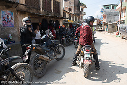 Motorcycle Sherpa's Bear Haughton on his Royal Enfield Himalayan ready to head out and lead our group on the Ride to the Heavens motorcycle adventure in the Himalayas of Nepal. This first day of riding took us from Kathmandu to Nuwakot. Monday, November 4, 2019. Photography ©2019 Michael Lichter.