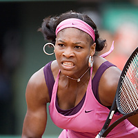 05 June 2007: US player Serena Williams rushes to the ball during the French Tennis Open quarter final match won 6-4, 6-3 by Justine Henin over Serena Williams on day 10 at Roland Garros, in Paris, France.