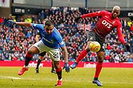 Alfredo Morelos & Youssouf Mulumbu of Kilmarnock challenge for the ball during the Ladbrokes Scottish Premiership match between Rangers and Kilmarnock at Ibrox, Glasgow, Scotland on 16 March 2019.