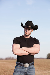 Rigged Cowboy With large arms folded outdoors