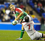 Reading, GREAT BRITAIN,   Shane GERAGHTY, feels the weight of Kieron DAWSON's tackle, during the third round Heineken Cup game, London Irish vs Ulster Rugby, at the Madejski Stadium, Reading ENGLAND, Sat., <br /> 09.12.2006. [Photo Peter Spurrier/Intersport Images]