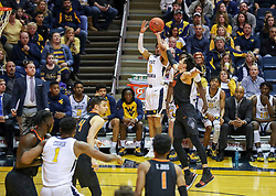 Jan 12, 2019; Morgantown, WV, USA; West Virginia Mountaineers guard James Bolden (3) shoots a three pointer during the second half against the Oklahoma State Cowboys at WVU Coliseum. Mandatory Credit: Ben Queen-USA TODAY Sports