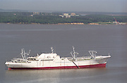 """Nuclear powered cargo ship SS Savannah mothballed with the """"ghost fleet"""" on the James River in Virginia. The Surry nuclear power plant is on shore directly behind the ship."""