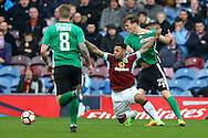 Andre Gray of Burnley © and Sean Raggett of Lincoln City (r) battle for the ball. The Emirates FA cup 5th round match, Burnley v Lincoln City at Turf Moor in Burnley, Lancs on Saturday 18th February 2017.<br /> pic by Chris Stading, Andrew Orchard Sports Photography.