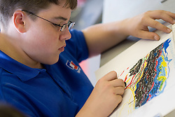 Student using impressionism technique with oil pastels,