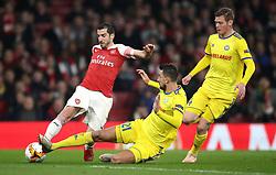 Arsenal's Henrikh Mkhitaryan (left) under pressure from FC BATE Borisov's Egor Filipenko (centre) during the UEFA Europa League round of 32 second leg match at the Emirates Stadium, London.